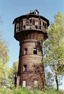 Abandoned water tower in the Polish village of Lubne Lesko County It serviced the village until the s when it was converted into a home Its been abandoned for many years now