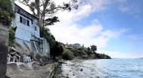 Abandoned waterfront home amidst the mansions of Point Richmond CA