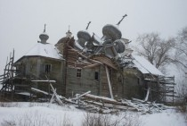 Abandoned wooden church in ruins in Vologodskaya Oblast Russia