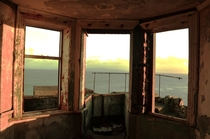 Abandoned World War lookout facing the sea during a stormy sunrise Torr Head Northern Ireland