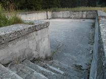 Abandoned Yugoslav swimming pool in the town of Glamo Bosnia