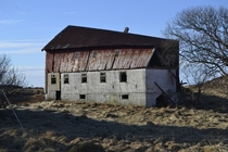 Abondoned barn weathered by ocean winds at Hustadvika Norway OCx