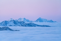 Above the clouds for a  degree sunrise in the North Cascades of Washington state USA