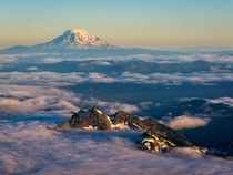 Above the clouds on Mount Rainier with Mount Adams in the background