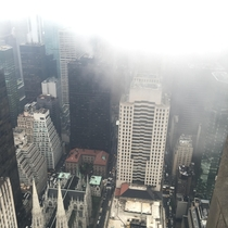 Above the clouds on Top of the Rock New York being slowly revealed as the weather changed