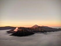 Above the clouds volcanos at sunrise Bromo Tengger Semeru National Park East Java Indonesia