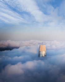Above the fog Heres the salesforce tower from a helicopter