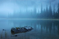 Absolutely one of the most eerie yet beautiful shots Ive seen to start the morning - Mary Lake Yoho National Park BC Canada  Photo by Peter Essick