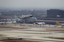 Accompanied by NASA FA- Hornet jets NASAs Space Shuttle Endeavour atop the Shuttle Carrier Aircraft or SCA performs a fly-by of Los Angeles International Airport on  September  in Los Angeles California United States of America Photographer Joel Kowsky NA