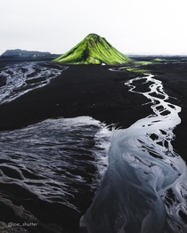 Across vast black sands and an intricate web of rivers formed by glacial melt-off there lies a lonely and improbable green hill In fact its a volcano This ladies and gentlemen is Mlifell Southern Highlands Iceland  Instagram joe_shutter
