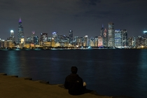 Admiring the Chicago skyline from across the harbor  Photographed by Rares Dutu