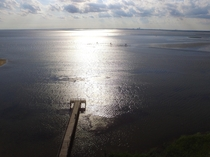 Aerial of Daphne pier late afternoon Mobile Bay and the city on the horizon  OC