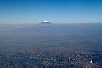 Aerial shot of Tokyo with Mount Fuji in the distance