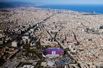 Aerial view of Barcelona while in the Camp Nou the farewell of legend Xavi its starting