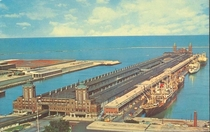Aerial view of Navy Pier in Chicago in the s Note the University of Illinois sign new filtration plant on the left ships along the pier