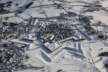 Aerial view of Rocroi France under snow