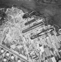 Aerial view of the dry docks at Pearl Harbor on  December  showing damage from the Japanese raid three days earlier