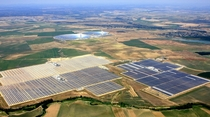 Aerial view of the unit I III and IV of Abengoa Solars Solnova Solar Power Station The two towers and reflective mirrors in the background are the PS and PS solar power plants