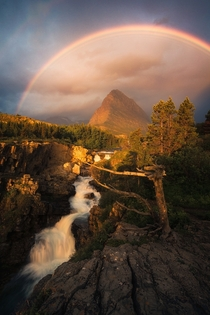 After an amazing lightning storm thick clouds broke just enough during sunrise to let this happen in Glacier National Park OC  ross_schram