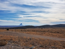 After days in the desert I stumble upon this monstrosity it is still  miles away here Shiprock Utah