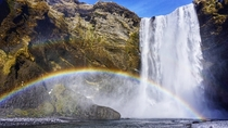 After days of grey skies we finally experienced some sunshine Couldnt have happened on a better day so we could witness a rainbow across Skogafoss Iceland