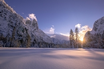 After days of heavy snow falling trees amp closed roads the storm breaks revealing a snow covered Yosemite Valley