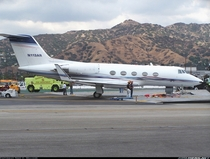 After overrunning Runway  at Burbank Airport a Gulfstream II jet is stopped from crashing through a fence and onto a busy roadway by an EMAS Engineered Materials Arrestor System a crushable concrete pad which traps the landing gear and stops the speeding