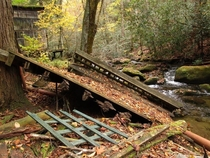 After years of abandonment and exposure to the elements back porches from vacation homes perched on the hillside have broken off and fallen into the nearby creek This was a common sight in the ghost town of Elkmont Tennessee