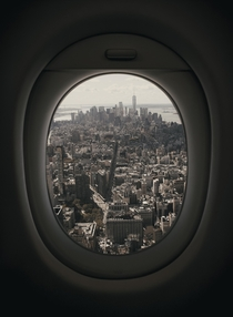 Airplane window view of Manhattan New York