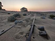 All that remains of tracks at Kolmanskop An abandoned German diamond mining town in Namibia They had a train station and also a train that moved people from one side of the town to the other