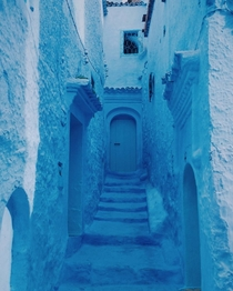 Alley in the city of Chefchaouen Morocco The city is located at the foot of Rif mountain range and is entirely painted in blue Chefchaouen is also known as the blue pearl