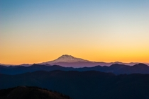 Alpenglow of Mount Adams Washington USA as seen at sunrise from Silver Star Mountain