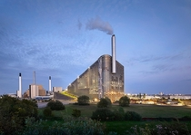 Amager Bakke is a waste-to-energy power station in Copenhagen covered by a dry ski slope and a climbing wall