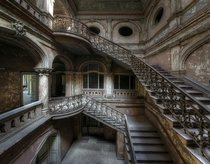 Amazing staircase inside an abandoned castle Photo by Niki Feijen