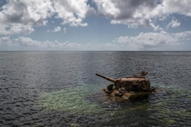 An abandoned A US Sherman tank off the coast of Saipan that has been the playground of reef fish since World War II