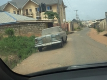 An abandoned and vintage  Mercedes-Benz  SEL quietly sitting at the corner of a road in Ibadan Nigeria