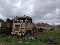 An abandoned army-truck hidden behind a burnt-out farmhouse in Leicester