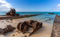 An abandoned barge and excavator on the Island of Middle Caicos Turks and Caicos