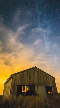 An abandoned barn under the moonlight