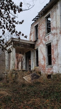 An abandoned burnt  year old farm house in Ohio