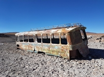 An abandoned bus covered with bullet holes in the Andes at the border between Chile and Bolivia  m of altitude - August