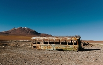 An abandoned bus in San Pedro de Atacama Chile  credit to F on Wikimedia