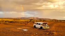 An abandoned car in the middle of nowhere Australia drive by shot