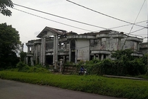 An abandoned half-completed mansion in Surabaya said to be haunted