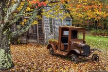 An abandoned home and a  Ford in Maine by Greg Hartford