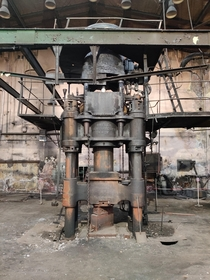 An Abandoned Large Forging Machine in a Shipyard