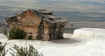 An abandoned Mausoleum submerged in a travertine pool at Hierapolis hot springs Turkey