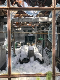 An abandoned mine building completely snowed in at Park City Utah