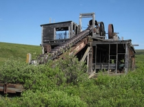 An abandoned mining dredge near historic Utica gold camp Seward Peninsula Alaska