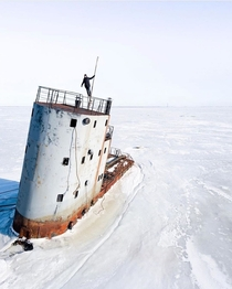 An abandoned nuclear ice breaker burried beneath the thick layers of snow in Kronstadt Russia